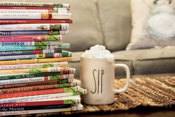Stack of picture books with hot cocoa
