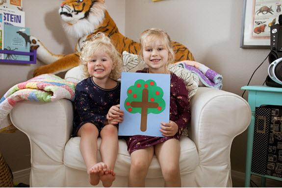 children show off their lowercase t craft