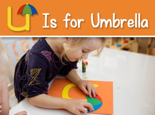 child applies a umbrella to her lowercase u craft