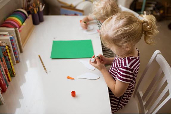 children working on their lowercase s craft