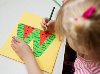 child draws on her lowercase w craft