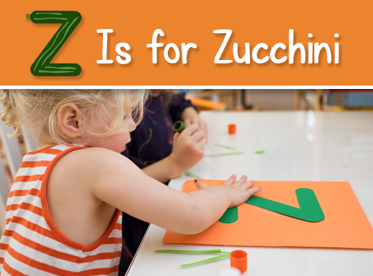 child works on her lowercase z craft