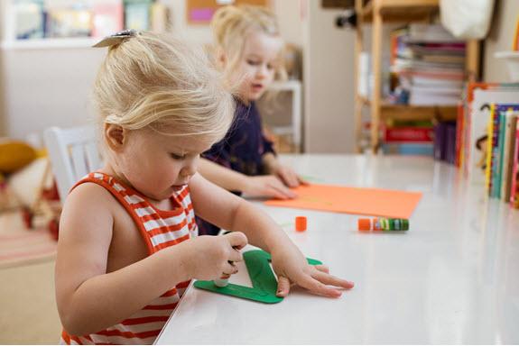 child glues her lowercase z craft