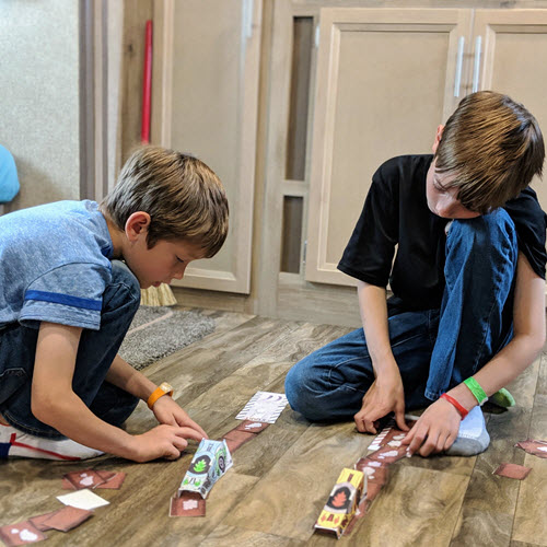 boys playing with drag race activity