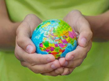 child holding a small globe