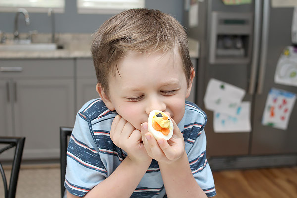 Child enjoying chick deviled egg