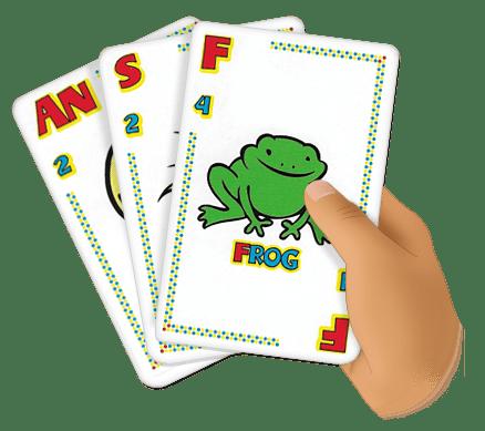 child holds quiddler cards