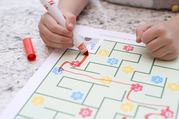 child drawing on a maze activity