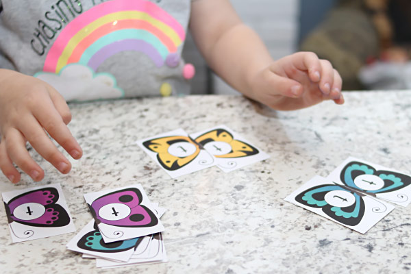 child matches butterflies with letters