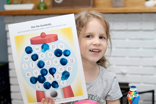 little girl shows her letter Y activity