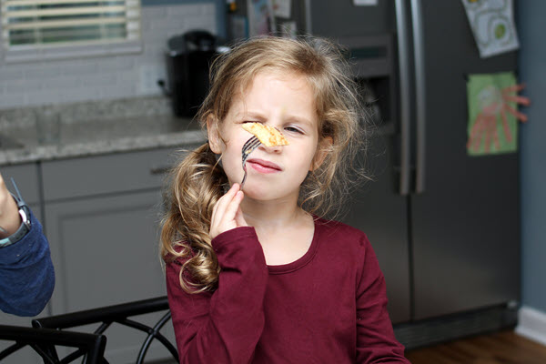 girl eating french toast