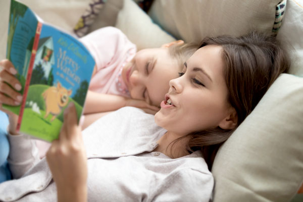 mother reading aloud to child