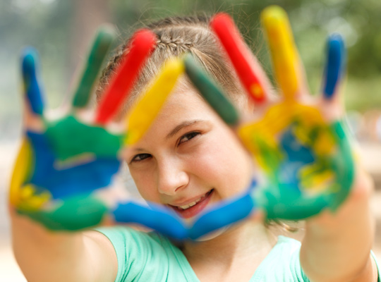 young girl with paint on her hands