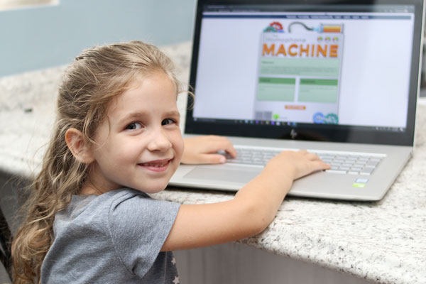 young girl playing with the homophone machine
