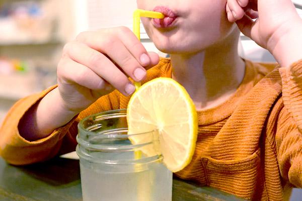 Little boy enjoying hoomemade lemonade